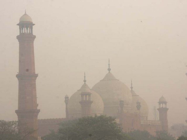 smog hangs in the air around badshahi mosque in lahore photo express file