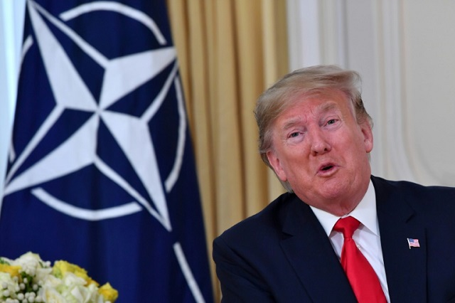 US President Donald Trump could not resist lashing out at French President Emmanuel Macron over his 'brain dead' NATO comments. PHOTO: AFP