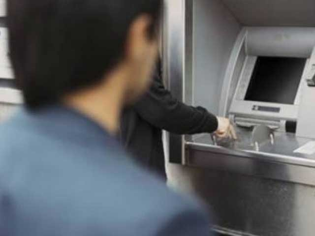 robber makes away with rs1 8m after looting atm in karachi