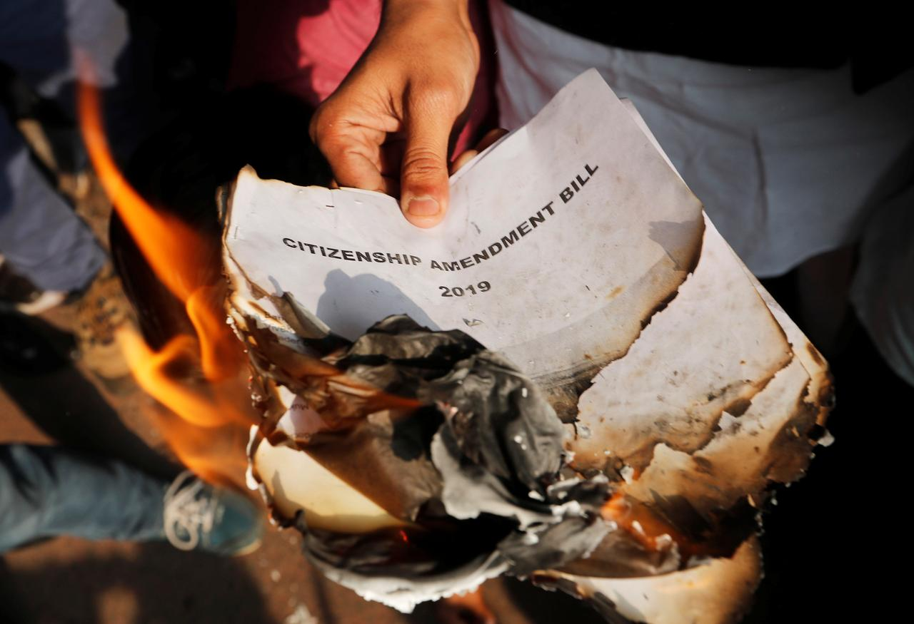 demonstrators burn copies of citizenship amendment bill a bill that seeks to give citizenship to religious minorities persecuted in neighbouring muslim countries during a protest in new delhi india december 11 2019 photo reuters