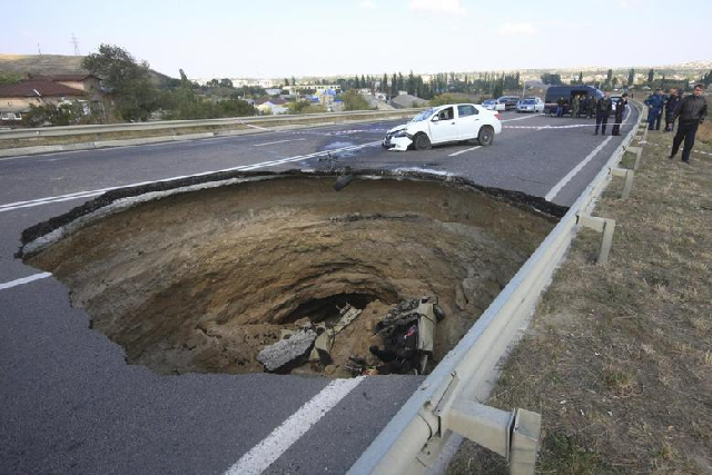 blame passed around for university road sinkhole