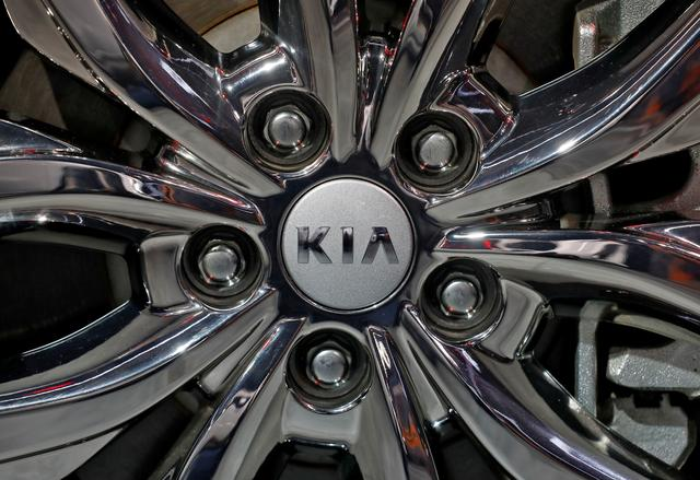 the logo of kia motors is seen on a wheel of its carnival car at the india auto expo 2020 in greater noida india february 5 2020 photo reuters