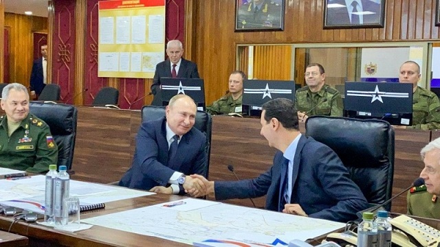 putin on surprise visit to syria as middle east boils