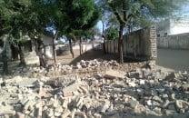 collapsed school wall crushes three children