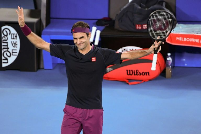 immaculate federer reaches australian open second round in style
