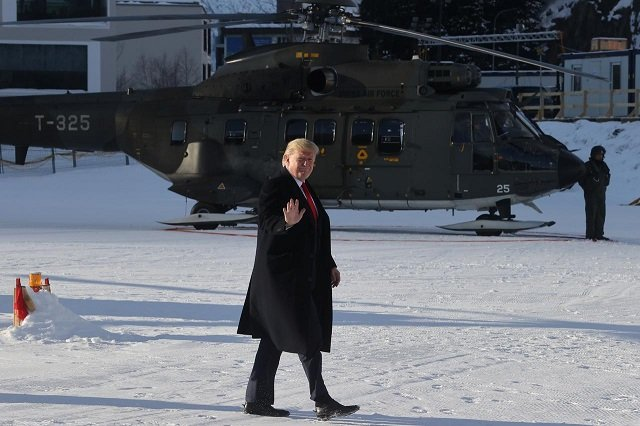 us president donald trump waves as he arrives for the 50th world economic forum wef in davos switzerland photo reuters