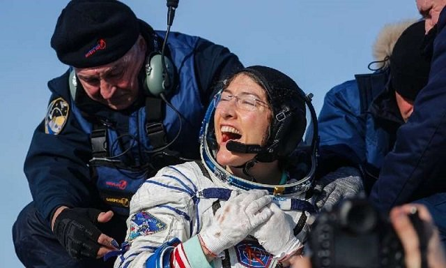 record breaking astronaut returns to earth after longest mission by woman