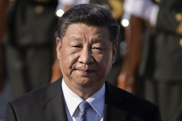 china president makes rare visit to meet virus workers patients