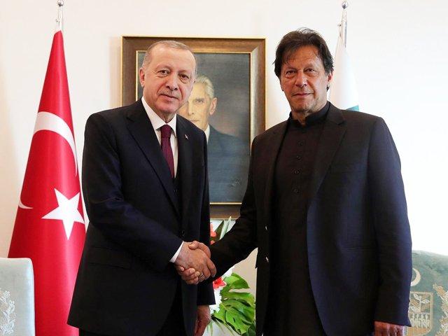In a file photo Prime Minister Imran Khan greets Turkish President Recep Tayyip Erdogan. PHOTO: PID