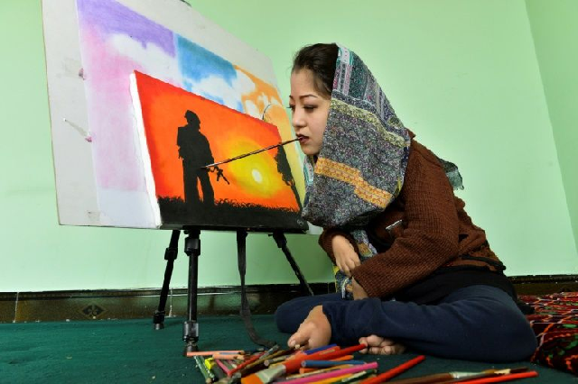 watch afghan artist brushes aside disability to open arts centre
