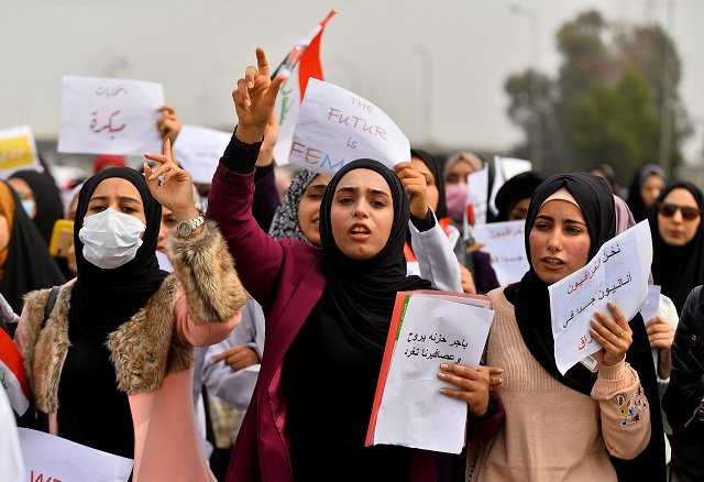 women stage rally in najaf show resolve to play key role in protest movement