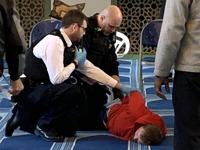 pictures on social media show police officers restraining a man in the prayer hall of the mosque near regents park photo twitter murshhabib