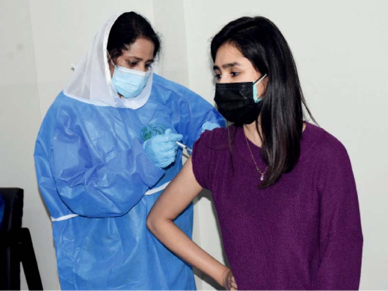 a health worker receives china s sinopharm covid 19 vaccine at the pakistan institute of medical sciences in islamabad photo online