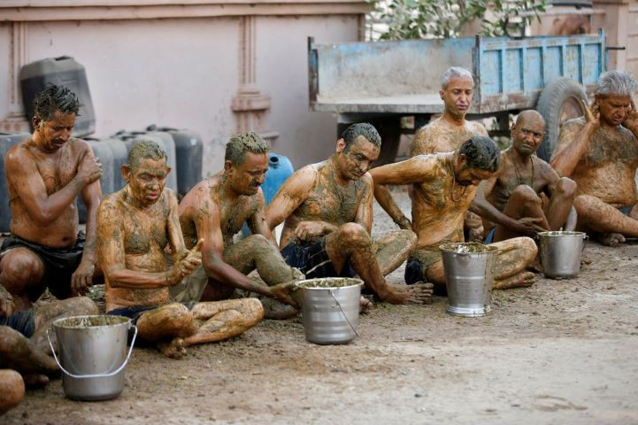 People apply cow dung on their bodies during