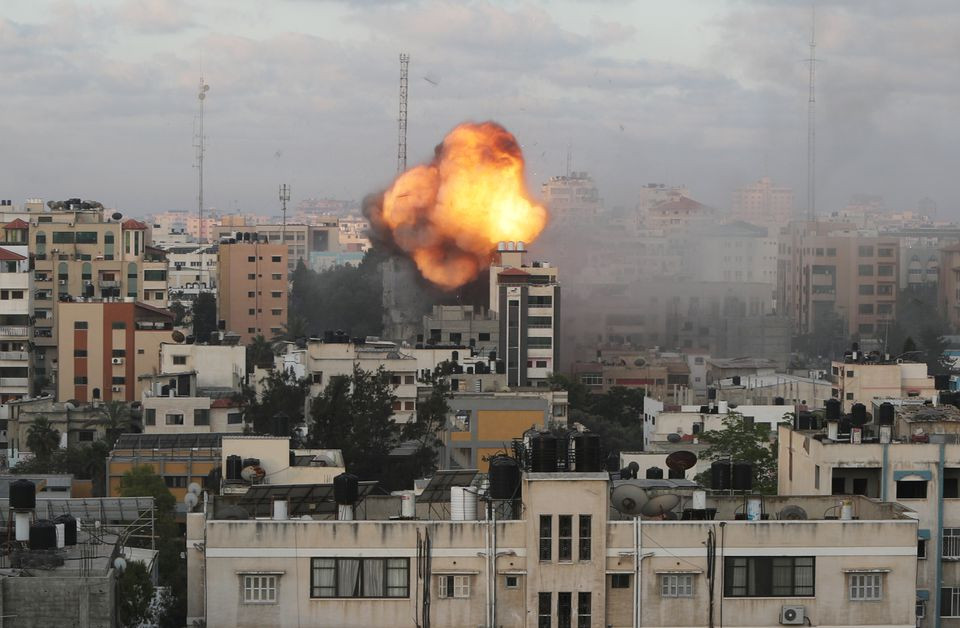 Smoke and flames are seen following an Israeli air strike on a building, amid a flare-up of Israeli-Palestinian fighting, in Gaza City May 18, 2021. PHOTO: REUTERS