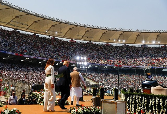 """U.S. President Donald Trump, first lady Melania Trum and Indian Prime Minister Narendra Modi attend a """"Namaste Trump"""" event during Trump's visit to India, at Sardar Patel Gujarat Stadium, in Ahmedabad, India, February 24, 2020. PHOTO: REUTERS"""