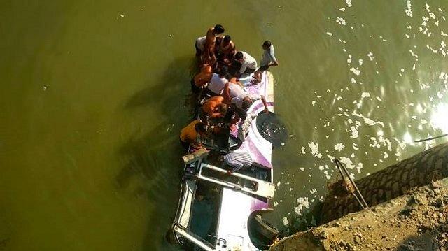 at least 24 dead as wedding bus falls off bridge
