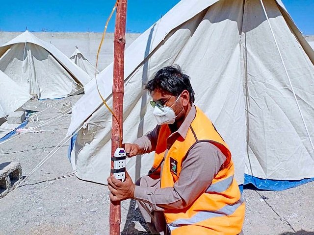 Arrangements are under way for a tent village set up for coronavirus suspects in Chagai. PHOTO: APP