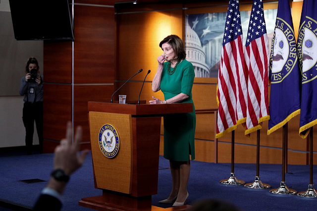 us house speaker nancy pelosi d ca wipes her nose while delivering remarks during a weekly news conference on capitol hill in washington us march 12 2020 photo reuters