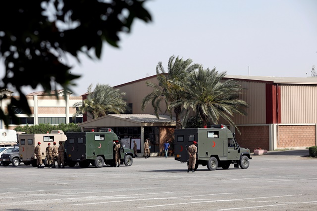 Military officers stand near parked ambulances at the premises of the Expo Center, after government declared it a mass isolation center and field hospital following an outbreak of the coronavirus disease (COVID-19), in Karachi.PHOTO/FILE REUTERS