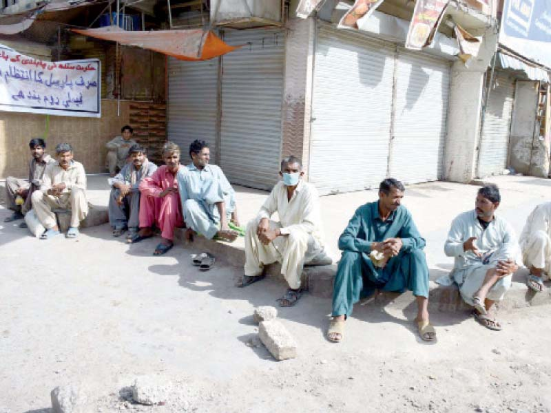 daily wagers and labourers sit idle on the roadside in karachi lack of employment due to the lockdown means they have no way of earning a livelihood and are one of the most badly affected groups in the current situation photo ppi