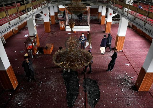 Men walk inside the Sikh religious complex after an attack in Kabul, Afghanistan March 25, 2020. PHOTO: REUTERS