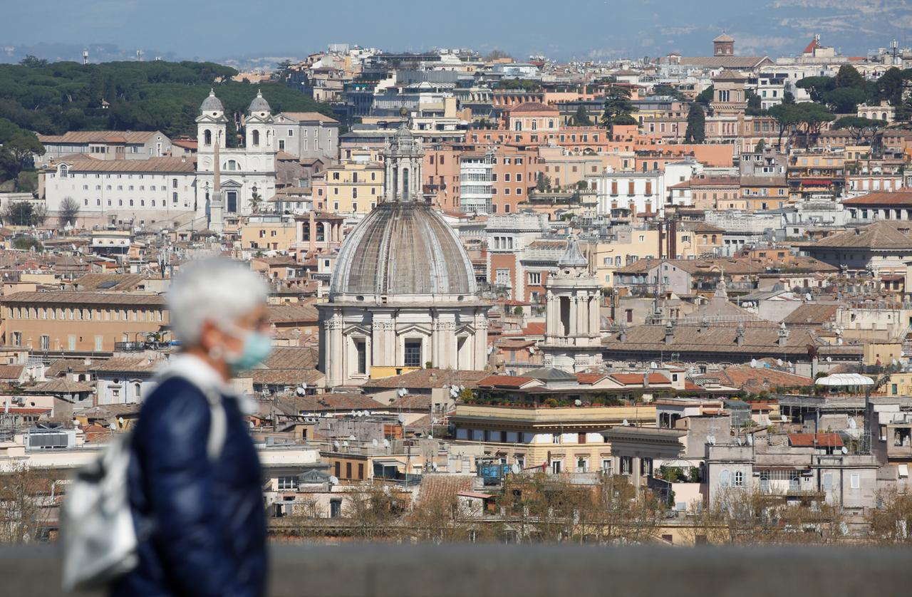 A woman walks at Gianicolo hill, as Italy tightens measures to try and contain the spread of coronavirus disease (COVID-19), in Rome, Italy. PHOTO: REUTERS