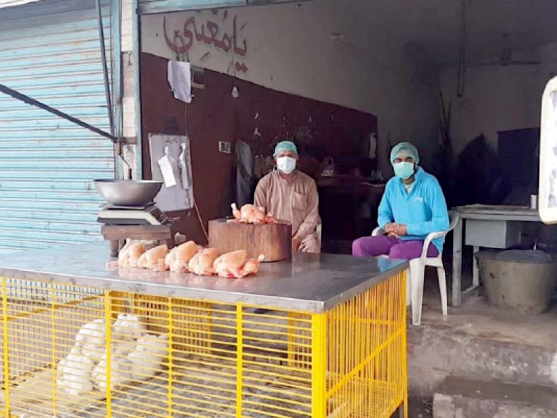 workers at a poultry shop wait for customers as business slumps in the provincial capital photo rizwan anwar express