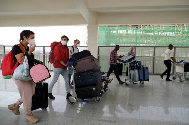 Foreign nationals  flying out of Nigeria's Abuja airport Sunday. PHOTO: AFP