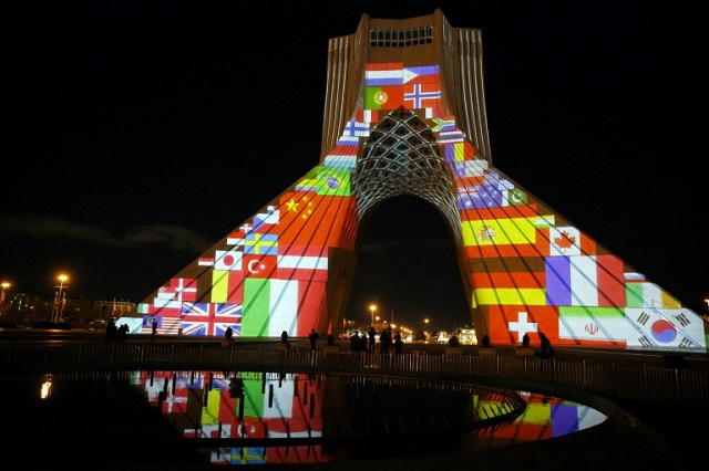 iran-039-s-azadi-freedom-tower-is-lit-up-with-flags-and-messages-of-hope-in-solidarity-with-all-the-countries-affected-by-the-covid-19-coronavirus-pandemic-photo-afp