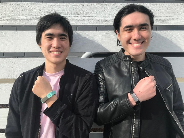 Entrepreneurs Matthew Toles and Joseph Toles, co-founders of the company Slightly Robot, show smartbands, the Immutouch, which buzz when the wearer's hand goes near their face, to prevent spreading the coronavirus disease (COVID-19), in Seattle, US, in this handout picture taken March 31, 2020. PHOTO: REUTERS