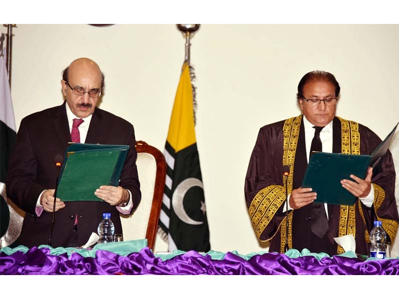 President Sardar Masood Khan administers the oath in a limited ceremony in the walk of coronavirus outbreak. PHOTO: EXPRESS