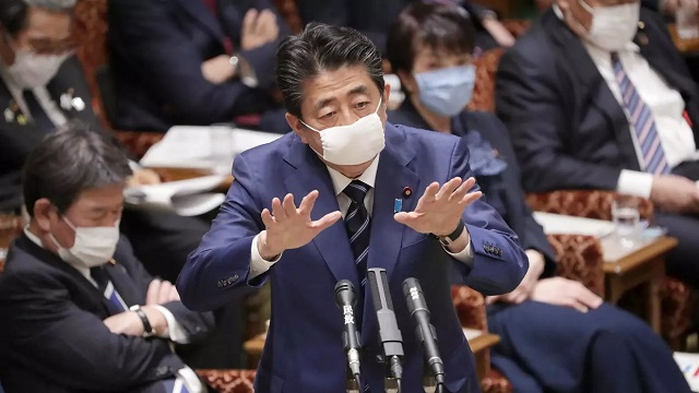 Japan's prime minister has in recent days begun sporting a small apparently homemade cloth mask. PHOTO: AFP