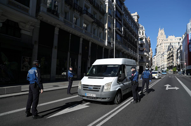 spain to extend state of emergency to april 26 as rise in infections slows