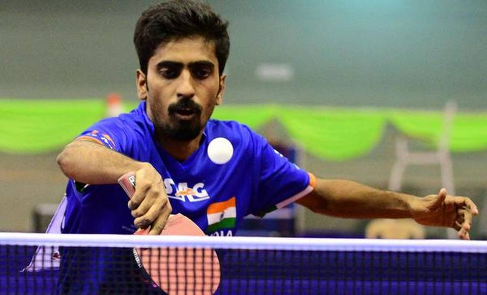country s top table tennis player says he is staying sharp by practising with a robot photo file
