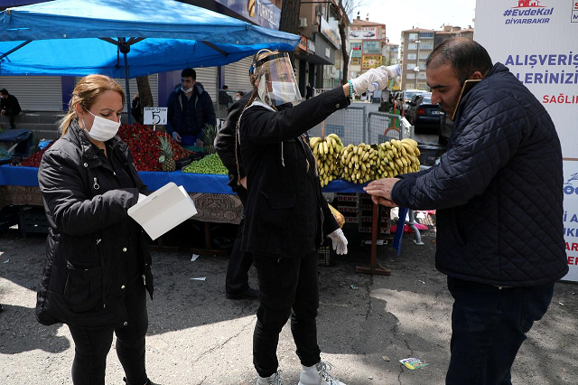 a municipal worker checks a man 039 s temperature as the spread of coronavirus disease covid 19 continues in diyarbakir turkey april 9 2020 photo reuters