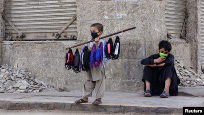 minors selling masks photo reuters