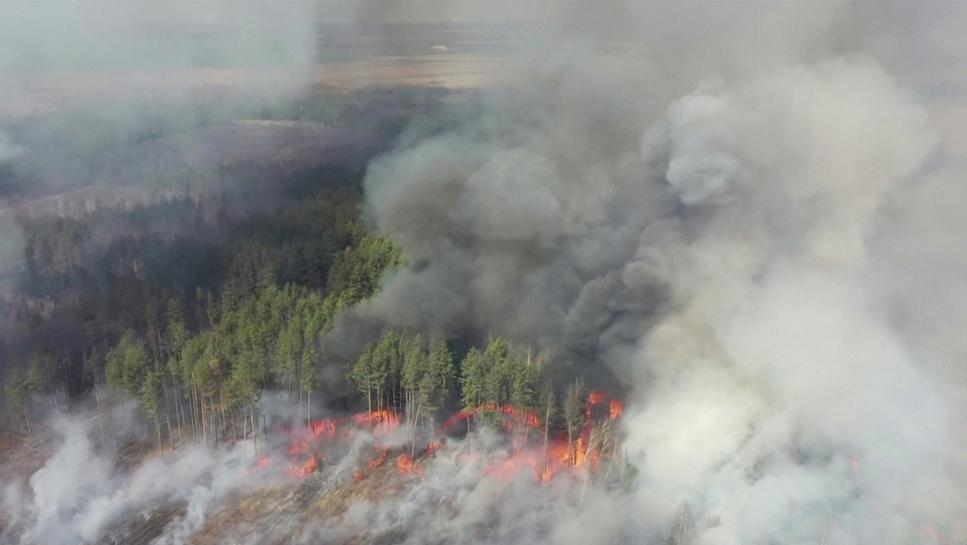 an aerial view shows a forest fire in the 30 km 19 miles exclusion zone around the chernobyl nuclear power plant ukraine april 12 2020 in this still picture taken from video photo reuters tv via reuters