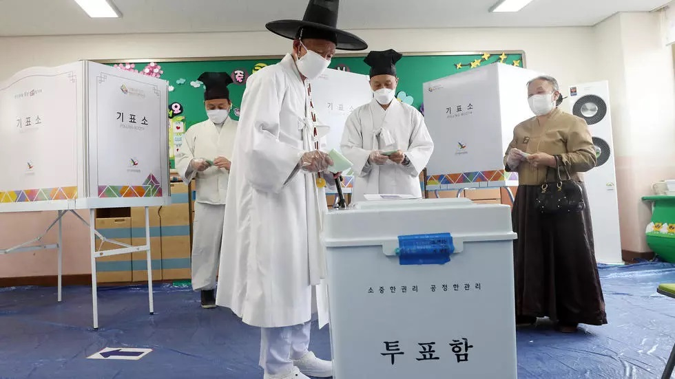 a south korean in traditional dress casts his ballot photo afp