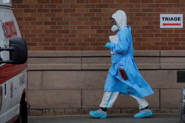 a healthcare worker is seen at the emergency center at maimonides medical center during the outbreak of the coronavirus disease covid 19 in the brooklyn borough of new york us april 14 2020 photo reuters