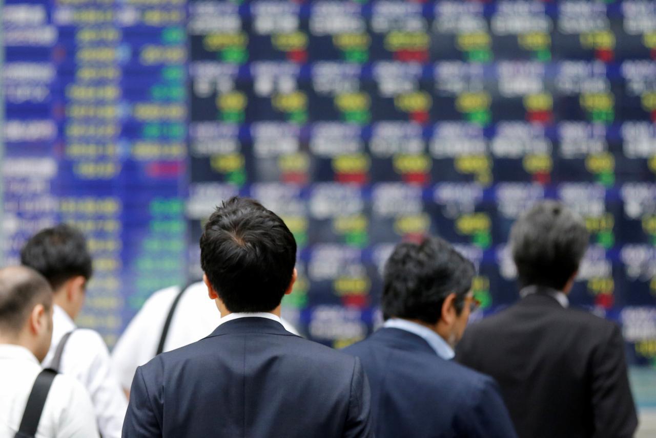 grim warnings over economic impact us halting funding for who worries investors photo reuters
