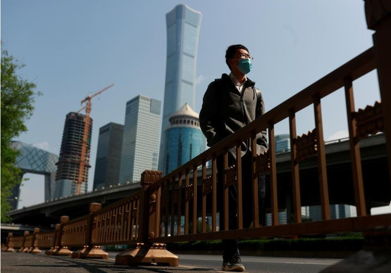 a walks by beijing 039 s central business district during morning rush hour as the spread of the new coronavirus disease covid 19 continues in china photo reuters