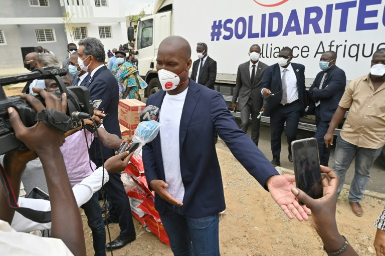 former ivorian striker didier drogba and one of the country 039 s biggest music groups magic system distributed aid on friday to 200 families in a poor area of abidjan as part of the effort to fight the coronavirus crisis photo afp
