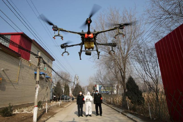 a volunteer in protective suits controls a drone to spray disinfectants at zhengwan village as the country is hit by an outbreak of the new coronavirus in handan hebei province china january 31 2020 photo reuters