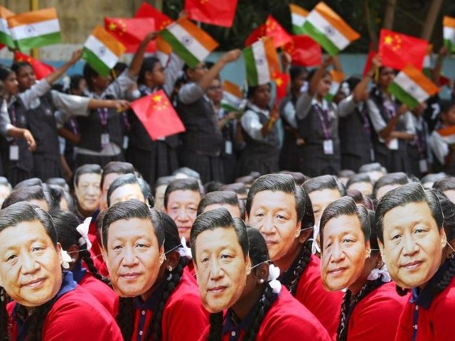 students wear masks of china 039 s president xi jinping as other waves national flags of india and china ahead of the informal summit with india s prime minister narendra modi at a school in chennai india photo reuters
