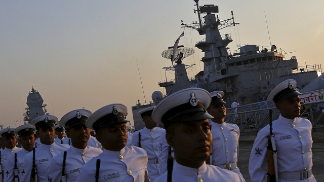 indian navy personnel leave after attending the decommissioning ceremony of india 039 s first indigenously designed and built warship the ins godavari at a naval base in mumbai photo reuters
