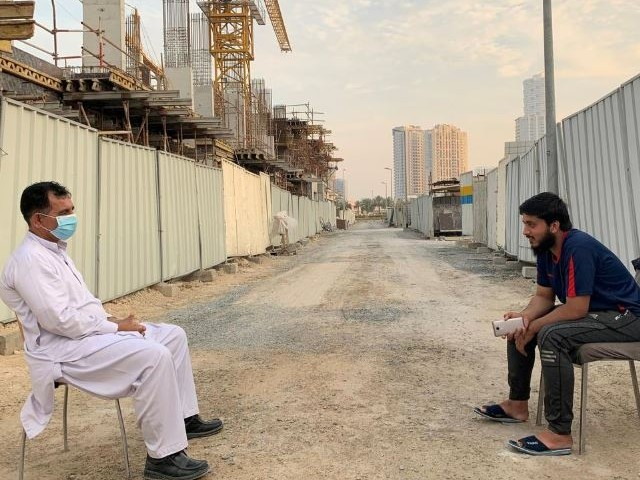 two guards working at a construction site keep distance during a lockdown to prevent the spread of coronavirus disease covid 19 in dubai photo reuters