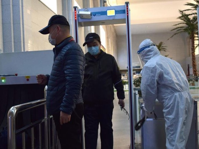 passengers wearing face masks go through security screening at the suifenhe railway station following an outbreak of the coronavirus disease covid 19 in suifenhe a city bordering russia in china 039 s heilongjiang province photo reuters