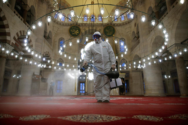 a municipality worker in a protective suit disinfects kilic ali pasha mosque due to coronavirus concerns in istanbul turkey march 11 2020 photo reuters