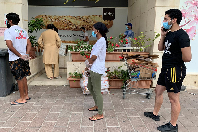 people keep distance in a line outside a supermarket to prevent the spread of the coronavirus disease covid 19 in dubai united arab emirates april 18 2020 photo reuters